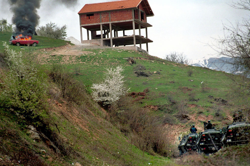 Macedonian armoured personnel carriers armed with heavy machine guns attack Gajre March 25, 2001 in the hills above Tetovo as Macedonian forces launched an offensive against the village to rout out Albanian rebels