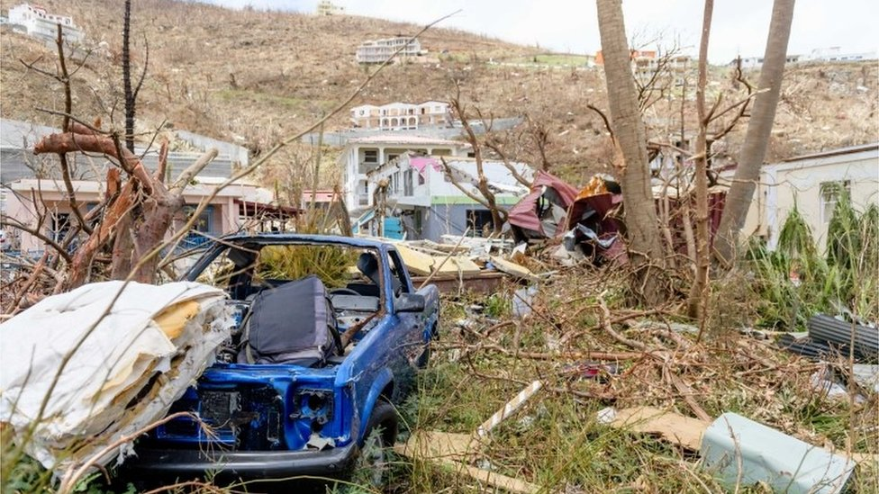 Wrecked cars and homes in the British Virgin Islands