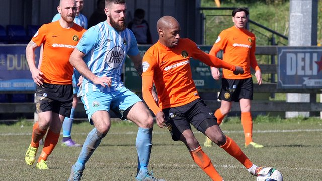 Action from Warrenpoint against Carrick Rangers