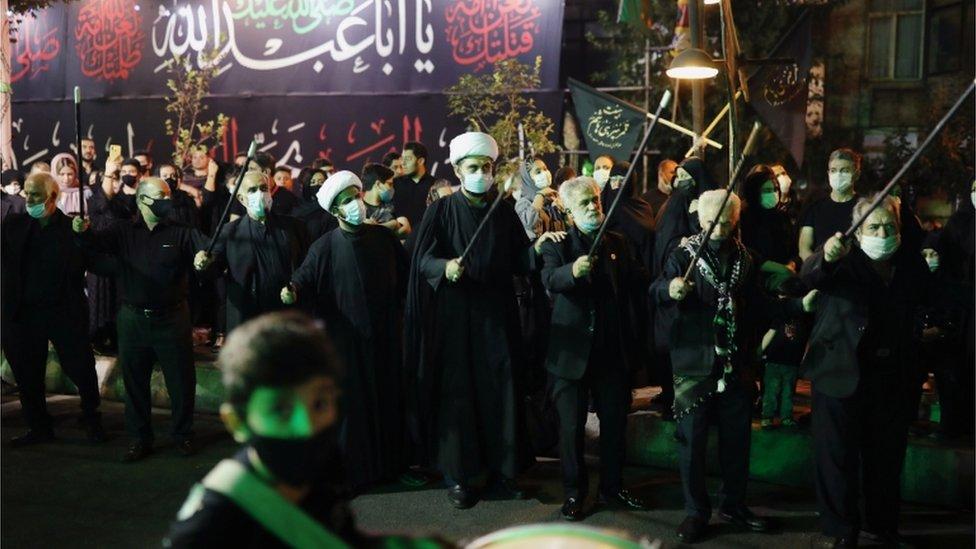 Iraníes en una celebración religiosa