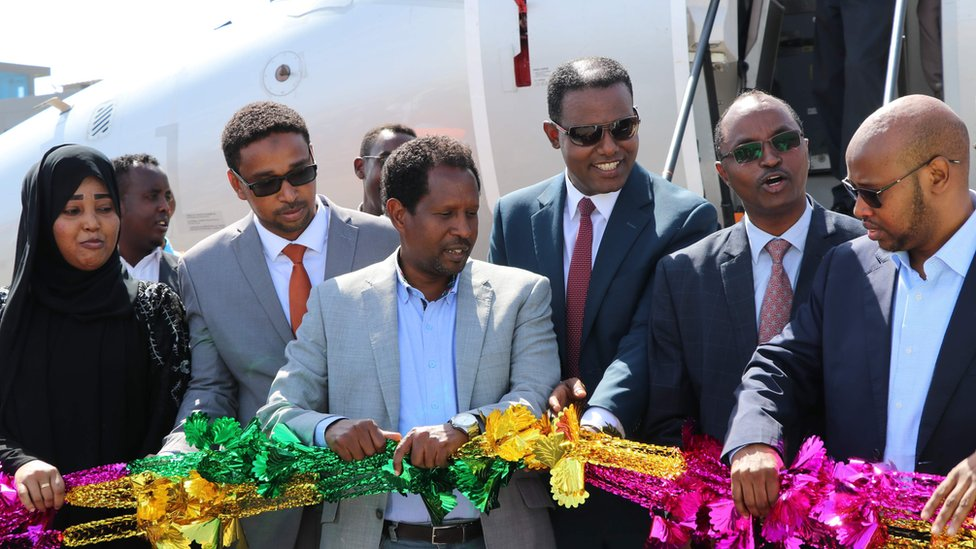Mayor of Mogadishu, Abdirahman Omar Osman (3rd L), and CEO of Ethiopias National Airways, Abera Lemi (3rd R), celebrate after the first commercial flight by National Airways linking Addis Ababa to Mogadishu in 41 years landed at Aden Abdulle international airport in Mogadishu, on October 13, 2018