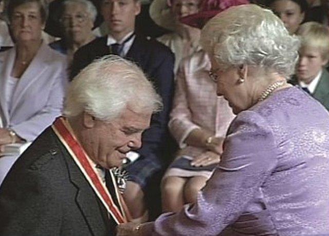 Sir Arnold receiving knighthood in 2004