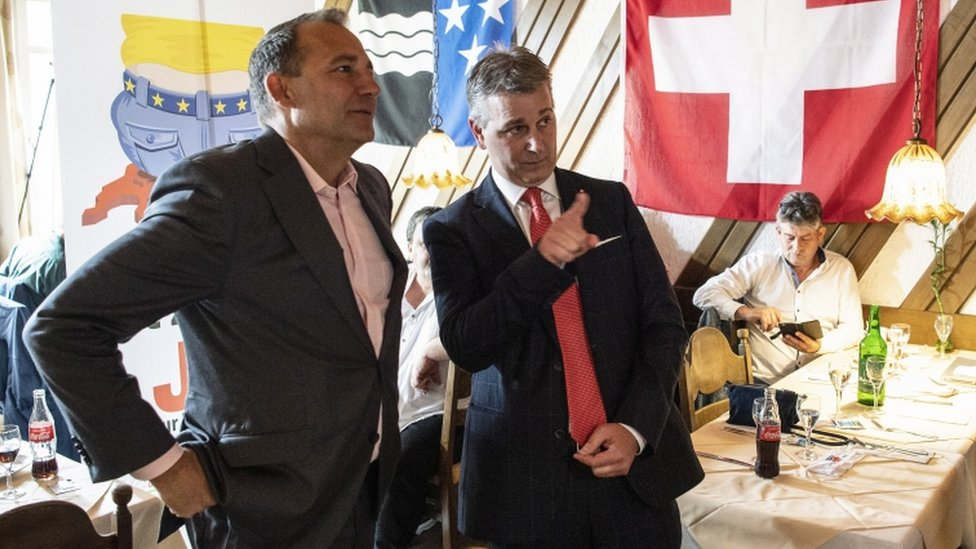 SVP President Marco Chiesa (R) and member of the national council Thomas Matter talk about the Limitation Initiative in Rothrist, Switzerland