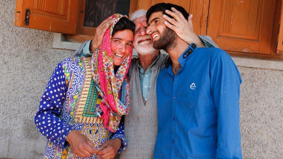 Kashmiri pandit Makhan Lal with Muslim friends