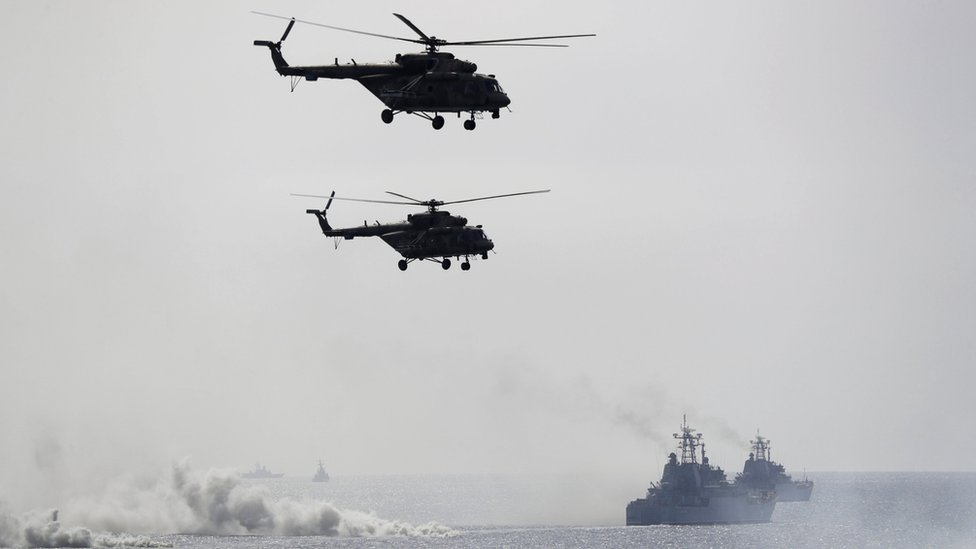 Russian navy ships and helicopters take a part in a landing operation during military drills at the Black Sea coast, Crimea,