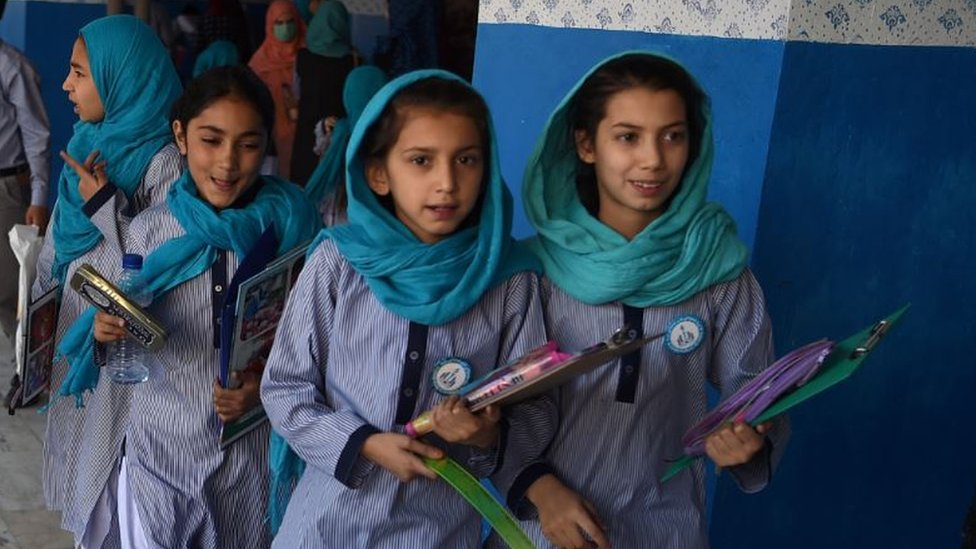 Afghan schoolgirls leave after the mid-term exams at a school in Kabul.