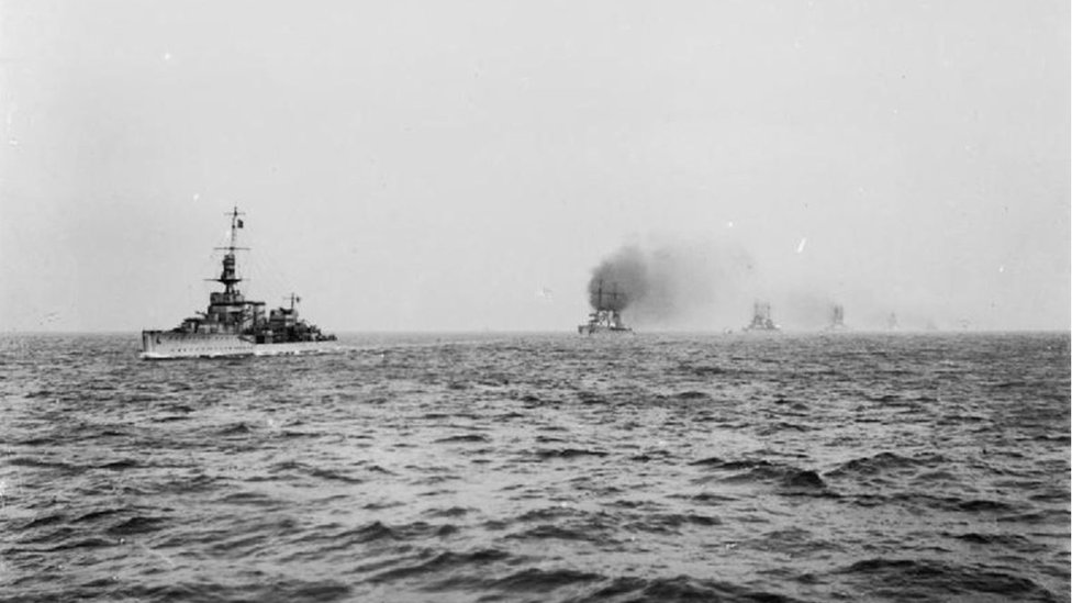 IWM - THE SURRENDER OF THE GERMAN HIGH SEAS FLEET, NOVEMBER 1918: Royal Navy light cruiser HMS Cardiff leading the German battle cruisers into the Firth of Forth.