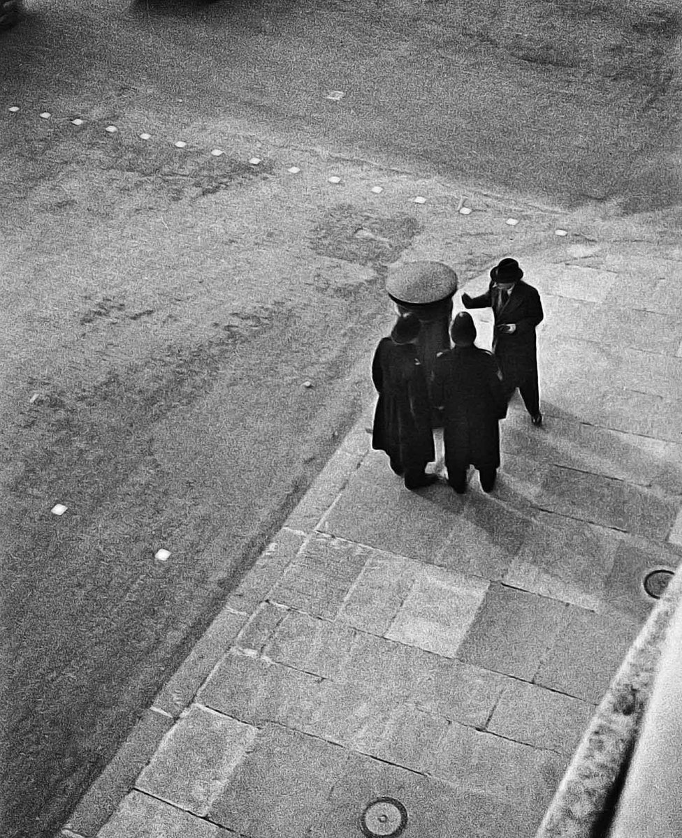 Policemen seen from above on Charlotte Street, London 1934