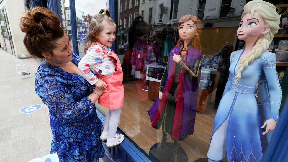 A mother and daughter at window of Disney Store in Dublin, 7 Jun 20
