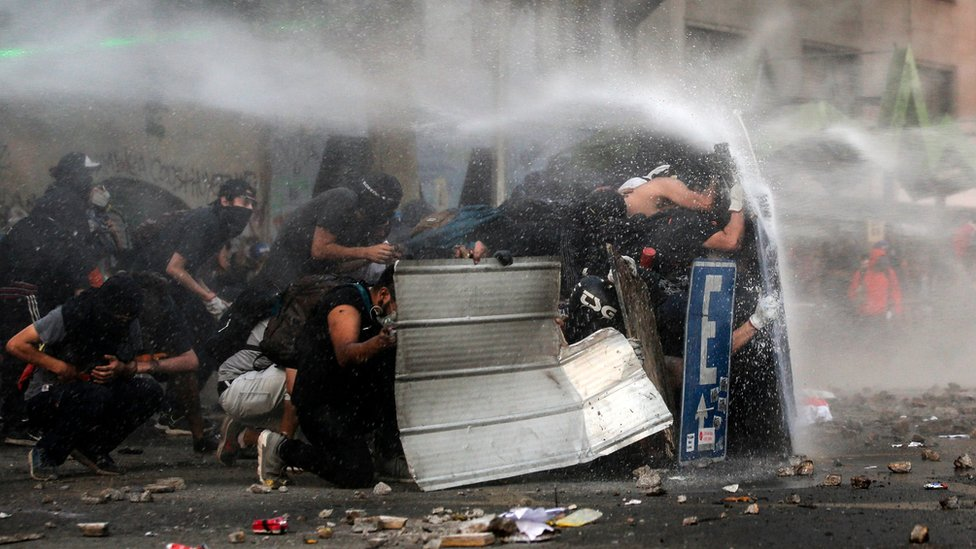 Demonstrators clash with riot police during a protest demanding greater social reform on 12 November, 2019.