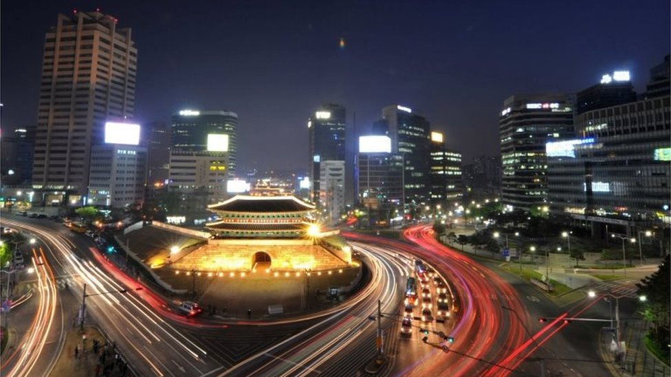 "Traffic commuting at night near South Korea""s landmark Namdaemun gate in Seoul"