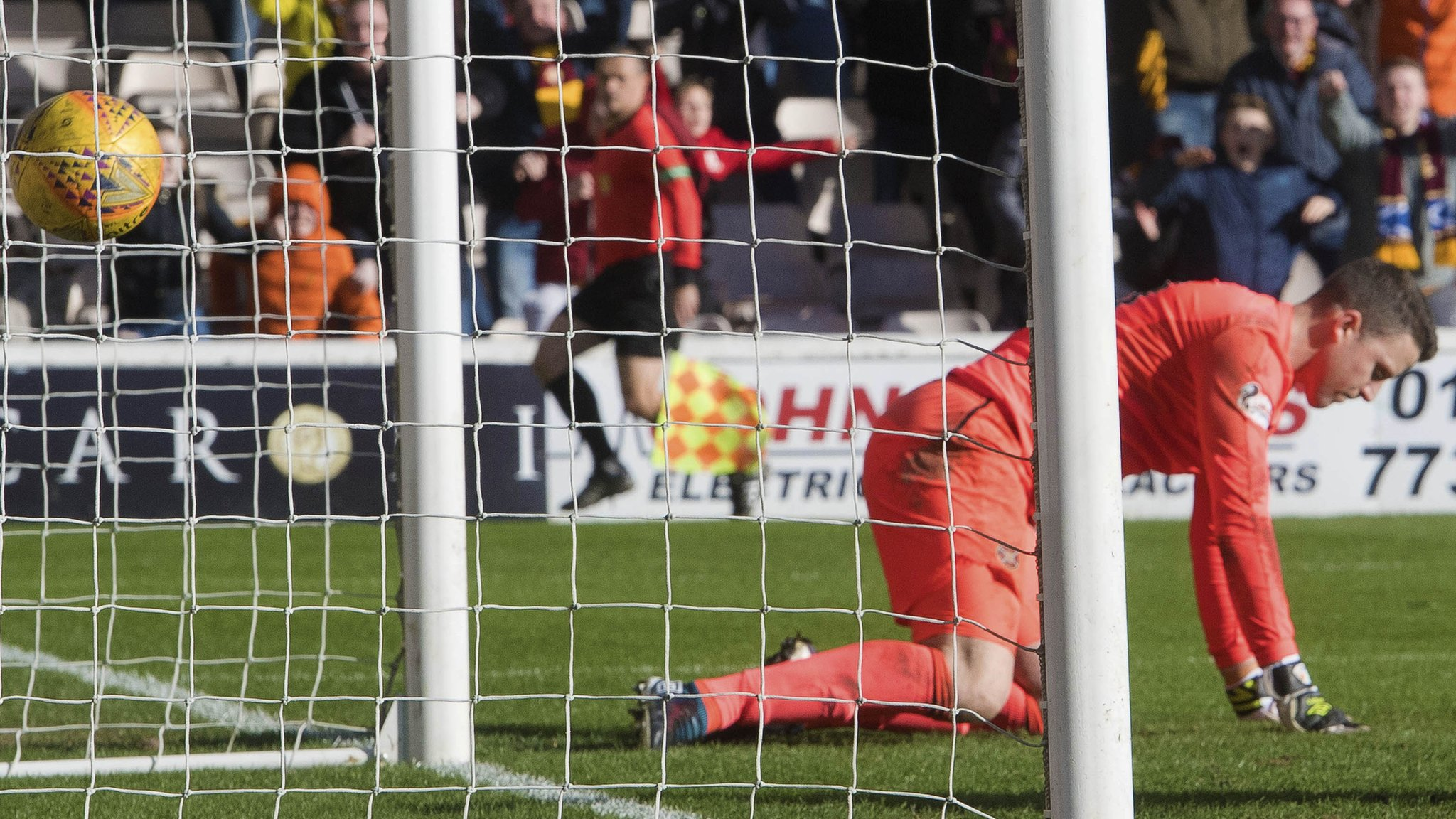 Motherwell extend winning run after howler by Hearts keeper Doyle