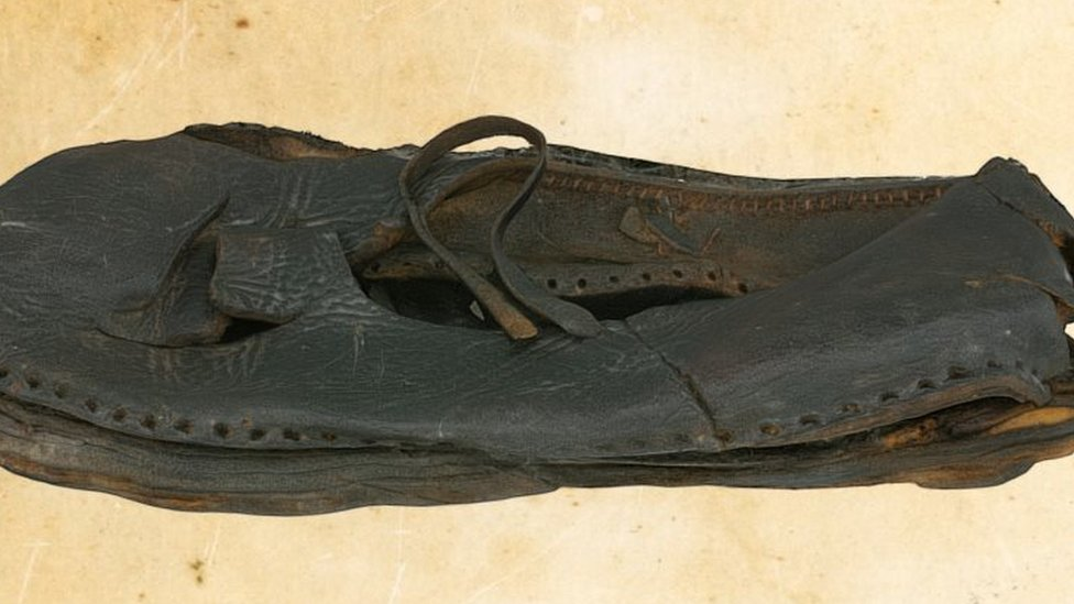 The project has also explored objects that belonged to the crew - such as this leather shoe