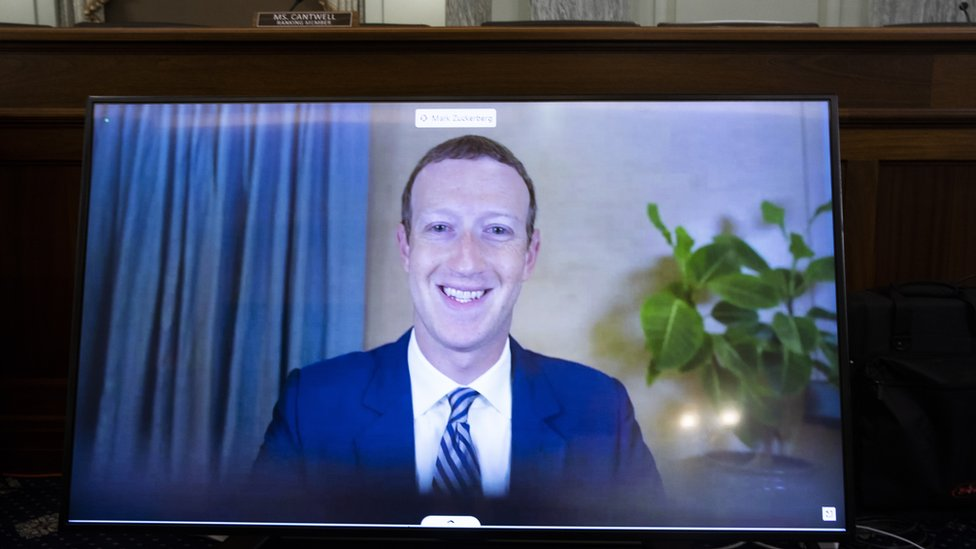 CEO of Facebook Mark Zuckerberg appears on a monitor as he testifies remotely during the Senate Commerce, Science, and Transportation Committee