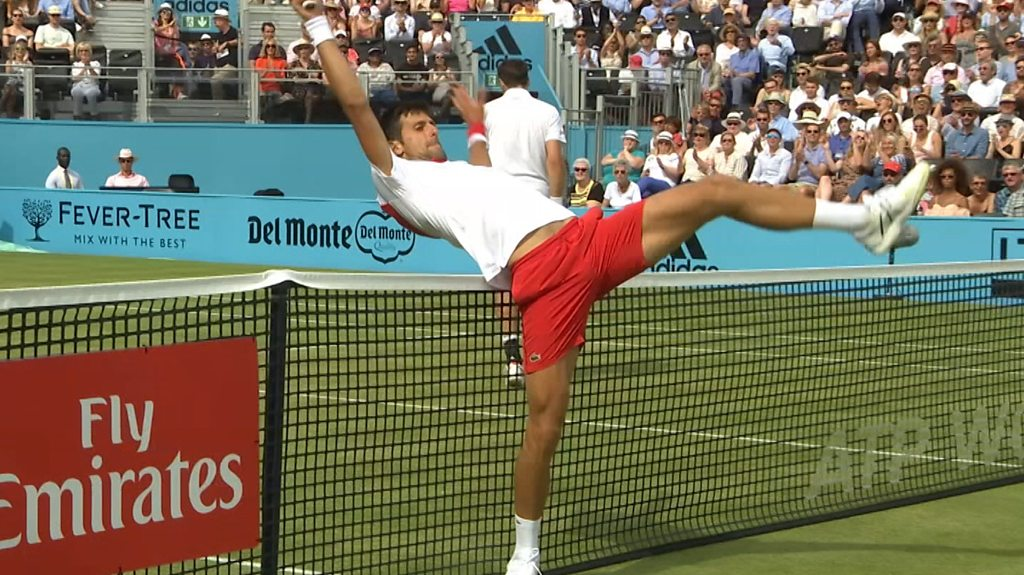 Unhappy Novak Djokovic loses point for touching the net
