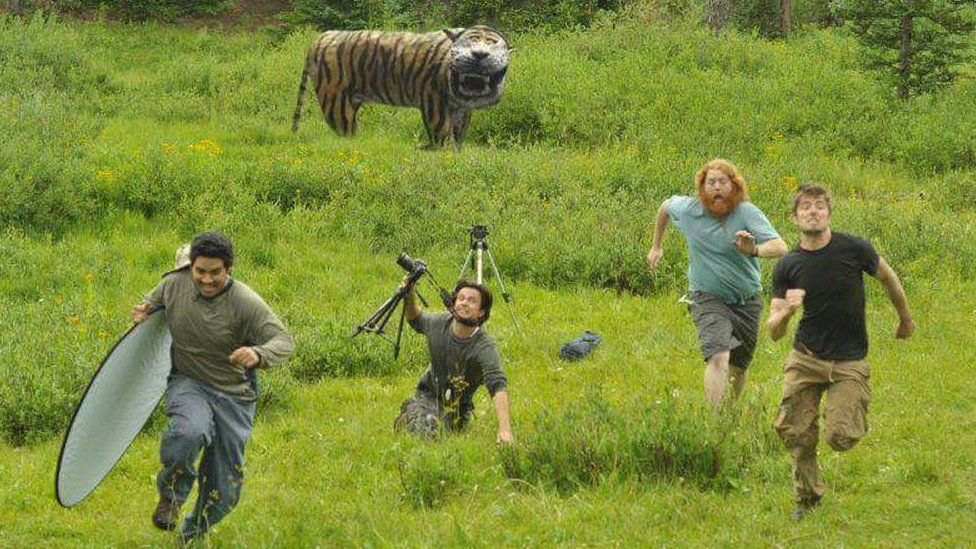 Mock up of film crew running away from the tiger
