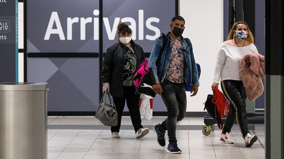 People arriving at an airport