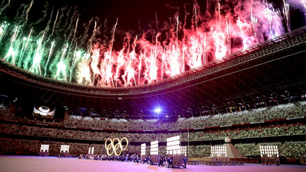 A general view inside the stadium as fireworks go off and performers dance during the Opening Ceremony of the Tokyo 2020 Olympic Games at Olympic Stadium on July 23, 2021 in Tokyo, Japan.