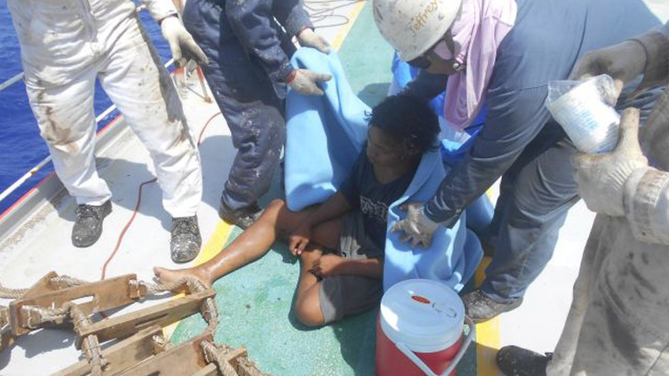 Adil is seen on a ship after being rescued