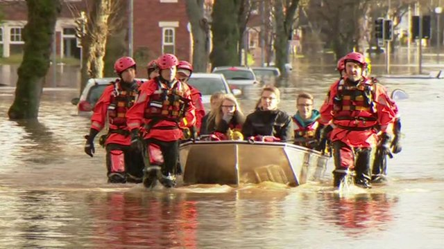 Residents being rescued by boat