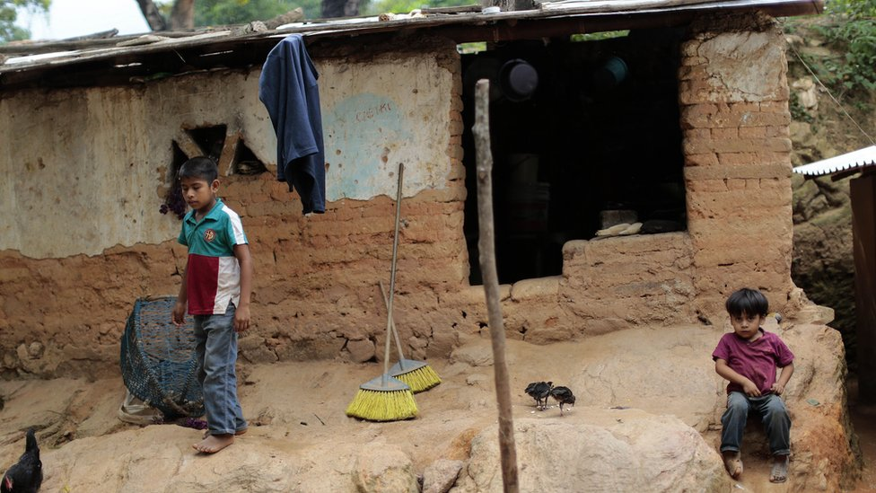 Children stay in front of their humble home in El Magueyito, Guerrero State, Mexico, on July 19, 2015.