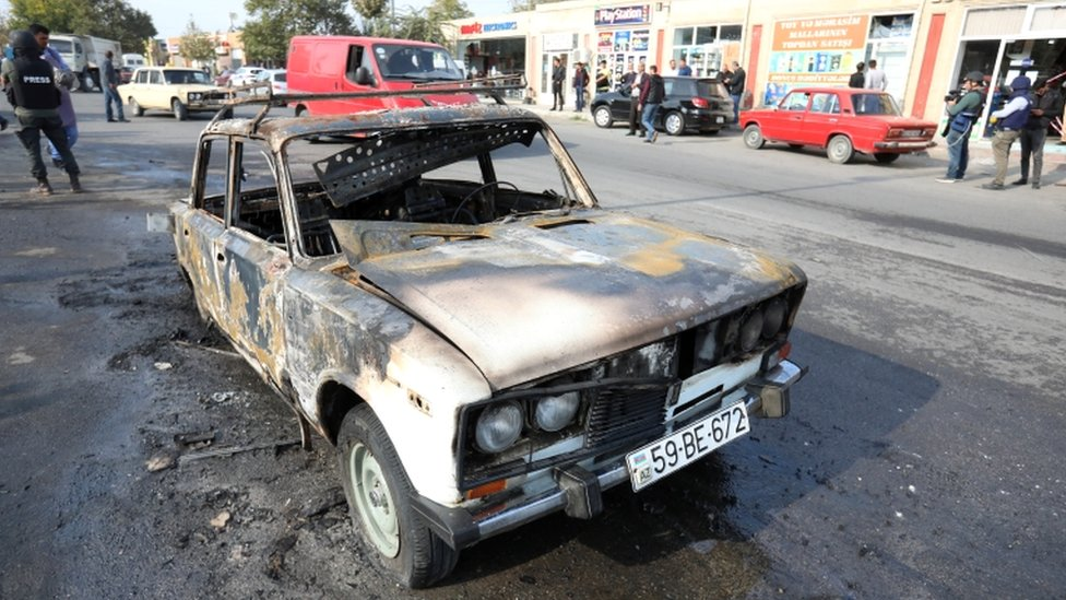 A burnt car, which was hit by shelling during a military conflict over the breakaway region of Nagorno-Karabakh, in the town of Barda, 28 October 2020