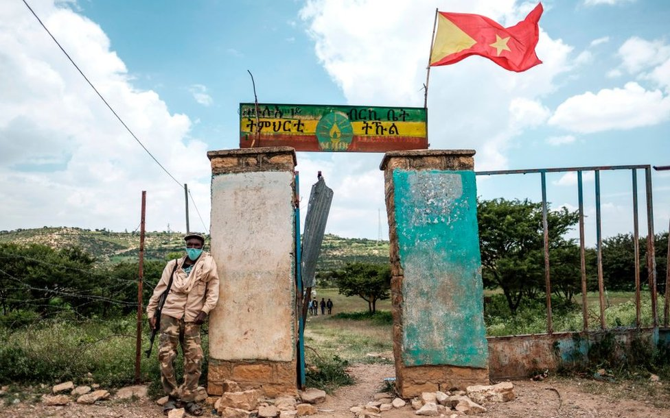An armed member of the community security stands in front of a school where a polling station is located during Tigrays regional elections, in the town of Tikul, 15 kms east from Mekele, Ethiopia, on September 9, 2020.