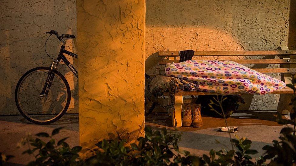 Homeless men and women sleep outside in Sarasota, Florida