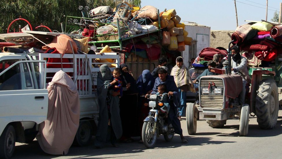 Afghans flee their villages after fighting intensified between Taliban militants and security forces, in Lashkar Gah, 12 October 2020.