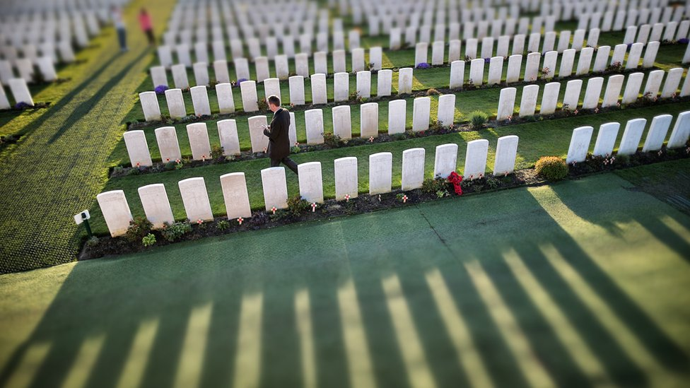 Visitors walk amongst rows of headstones at Tyne Cot Commonwealth War Graves Commission cemetery on March 24 2014 in Passchendaele, Belgium.
