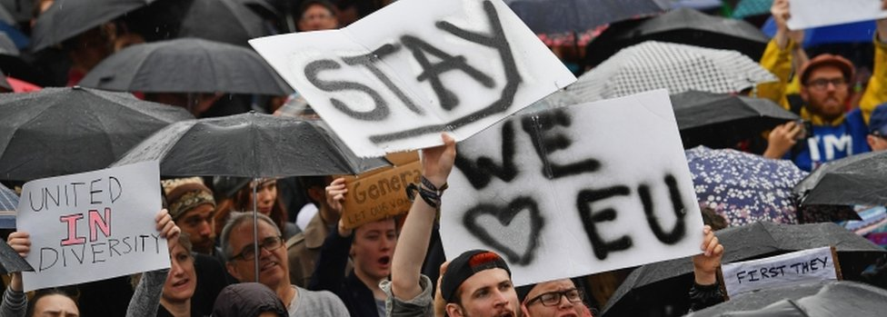 "Signs reading ""stay"" and ""we love EU"" at a rally on June 28"