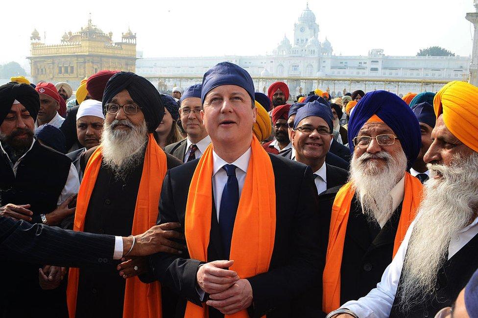 ritish Prime Minister David Cameron (C) along with Punjab State Chief Minister Parkash Singh Badal (2L), and Shiromani Gurdwara Parbandhak Committee (SGPC) President Avtar Singh Makkar (2R) visit the Sikh Shrine Golden temple in Amritsar on February 20, 2013