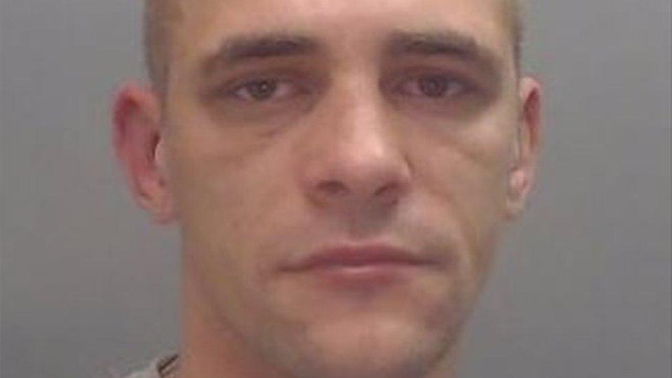 Knifepoint robber Daniel Ward bit hole in police officer's ear