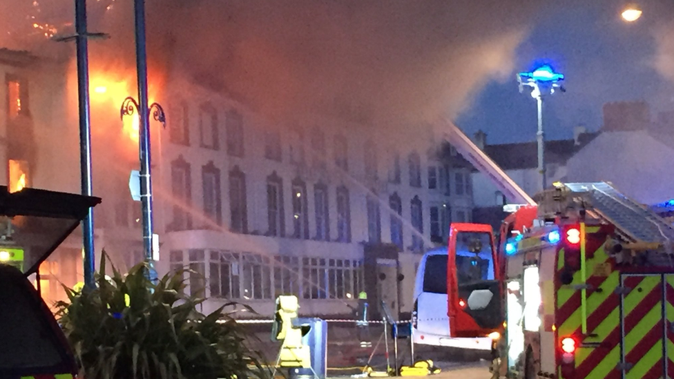 Fire engine spraying water at the hotel fire
