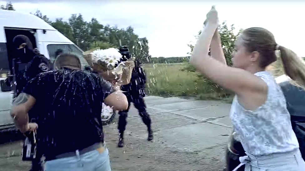 Screenshot of Yulia throwing flowers at her husband-to-be