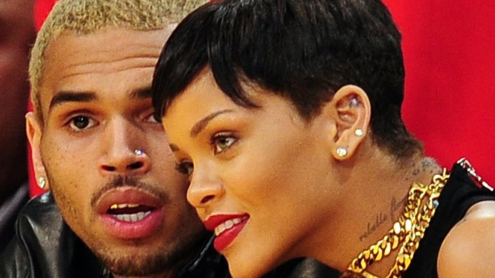 Rihanna (right) and Chris Brown (left) attend a game between the New York Knicks and the Los Angeles Lakers in Los Angeles (December 2012)