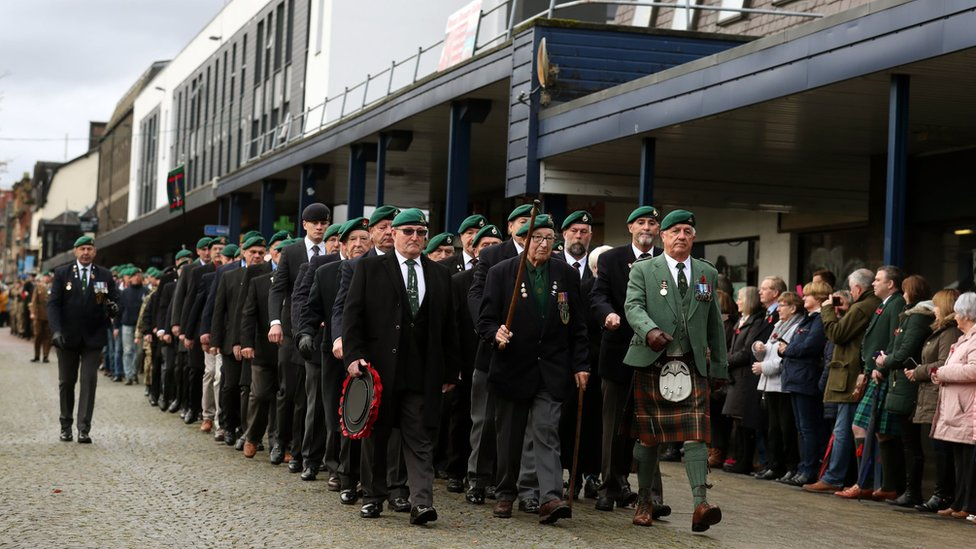 Veterans take part in a remembrance parade and service in Fort William