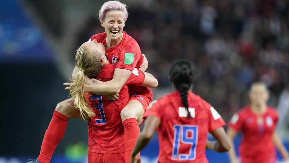 United States' midfielder Sam Mewis (L) celebrate with United States' forward Megan Rapinoe (C) after scoring a goal during the France 2019 Women's World Cup Group F football match between USA and Thailand