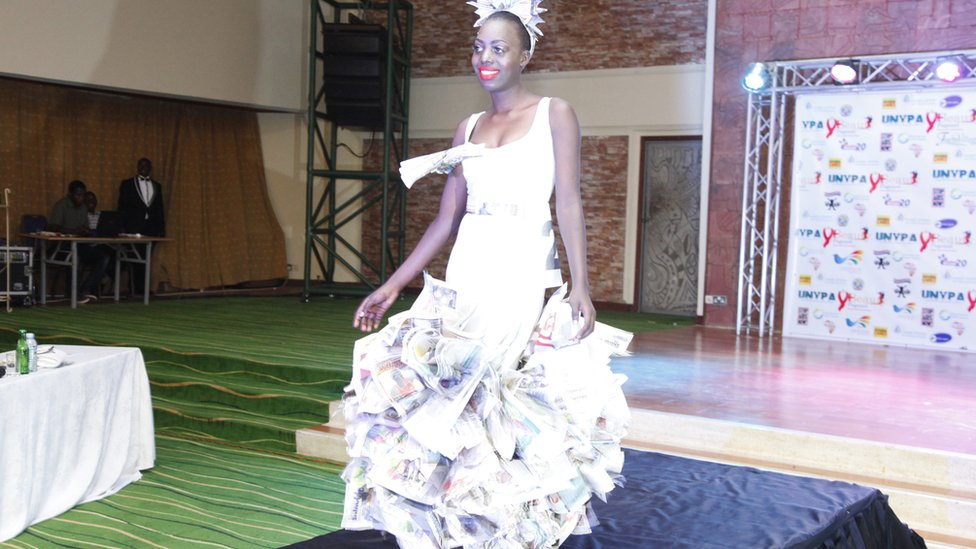A Ugandan woman wears a paper dress during a beauty contest in Kampala, Uganda - Saturday 24 September 2016