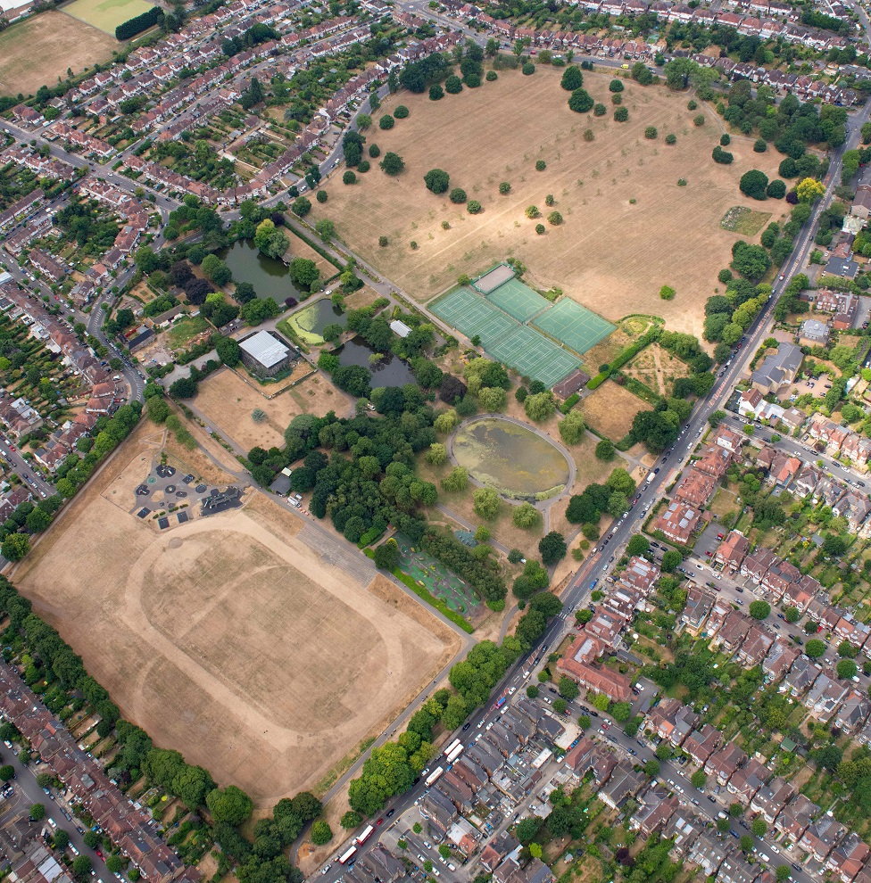 The grass on playing fields near Arnos Grove, North East London, is seen scorched and yellow