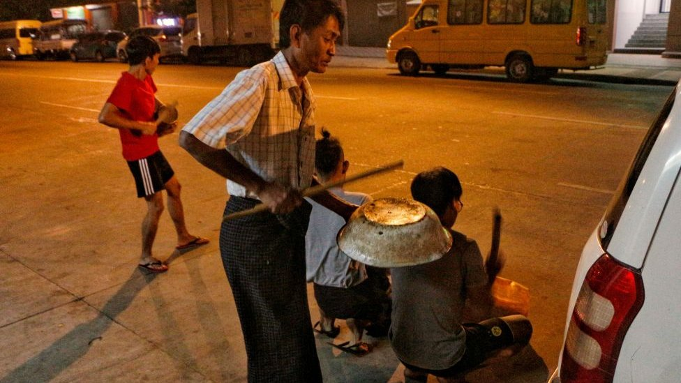 Residents bang pots and pans in Yangon