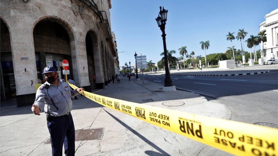 A police officer guards the areas surrounding the Capitol in Havana after anti-government unrest
