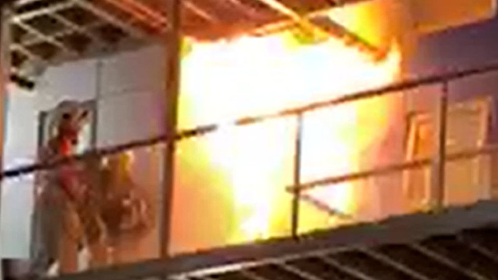 Handout videograb of fire fighters tackling the fire after it had just started on the top floors of a student accommodation building in Bolton