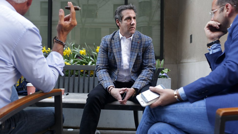 """Michael Cohen (C), U.S. President Donald Trump""""s personal attorney, chats with friends near the Loews Regency hotel on Park Ave on April 13, 2018 in New York City."""