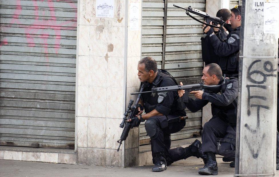 Riot agents hold their rifles at an entrance of Vila Cruzeiro shantytown in Rio de Janeiro, Brazil on 25 November, 2010