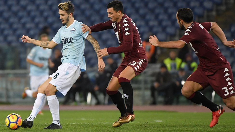 "Lazio""s Spanish midfielder Luis Alberto vies for the ball with Torino""s Argentinian defender Nicolas Burdisso during match"
