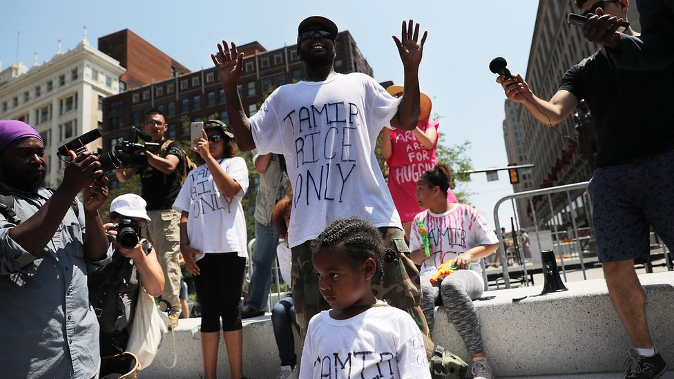 A man protests against the shooting of 12 year-old Tamir Rice by police near the site of the Republican National Convention.