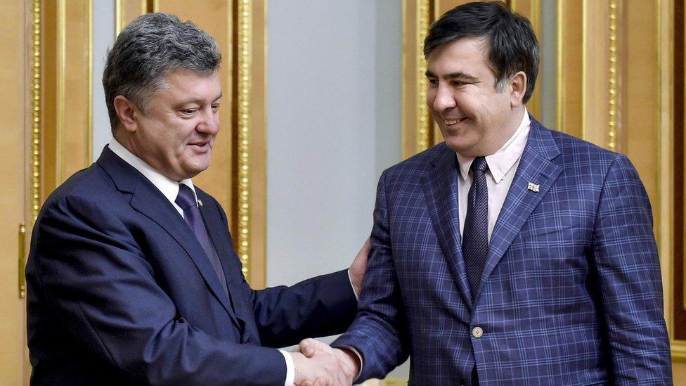 Ukraine's president Petro Poroshenko and Mikhail Saakashvili shake hands during a meeting in 1 June 2015