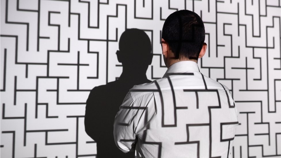 Man standing in front of labyrinth