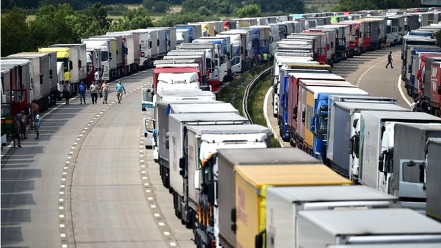 Trucks are parked on both the northbound and southbound carriageways of the M20